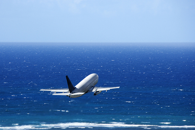 Airplane low over the ocean